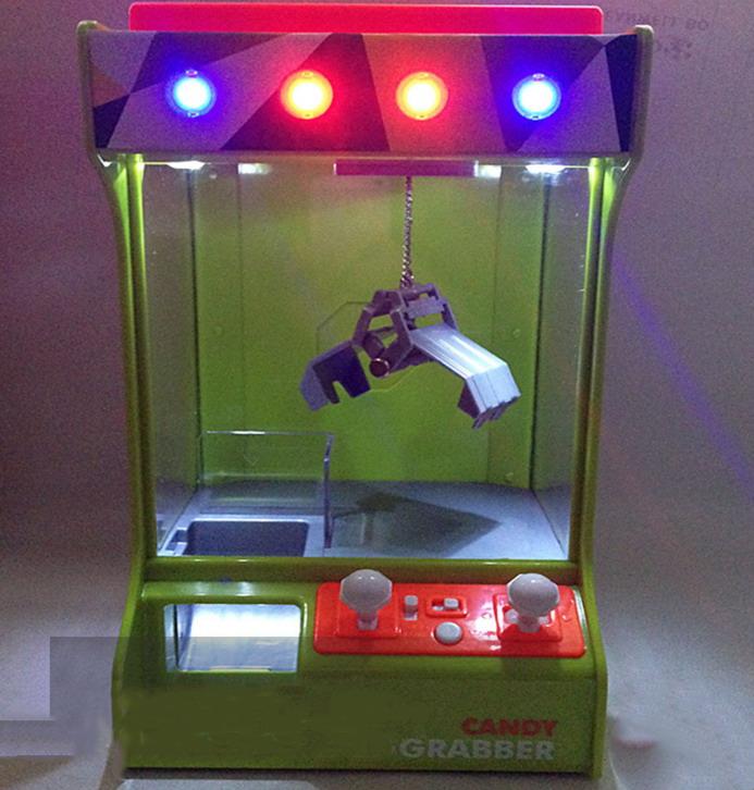 Игровой автомат вытяни конфету